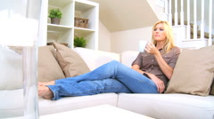 Blonde Girl Relaxing with Coffee - stock footage