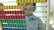 Stock Video Footage of Little Boy using abacus