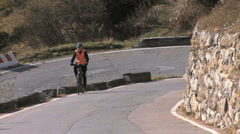 Italy bicycle up alpine switchback Stock Footage