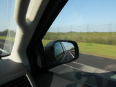 Stock Video Footage of Driving in Florida. Fence and mangroves. SD.