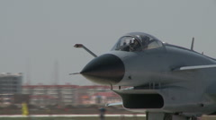 J-10 Fighter aircraft air show: two Fighters on taxiway - stock footage
