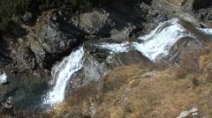 Italy Stelvio Pass waterfall looking down Stock Footage