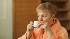 Senior woman drinking coffee Stock Footage