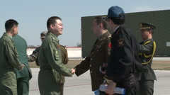 J-10 Fighter aircraft: Chinese pilot and foreign military attache shaking hands Stock Footage