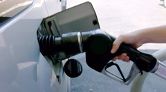 Placing Gas Pump on Car (HD) - stock footage