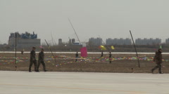 J-10 Fighter aircraft show: soldiers patrolling on the airfield Stock Footage