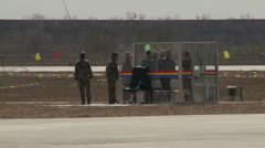 J-10 Fighter aircraft show: soldiers wait for take off on the air field Stock Footage