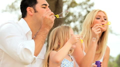 Multi-Ethnic Family Fun Blowing Soap Bubbles - stock footage