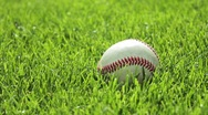 Stock Video Footage of Baseball in grass, picked up by player