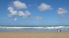 Timelapse white clouds over Fistral beach Stock Footage
