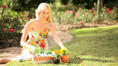 Young Blonde Female Gardening Stock Footage