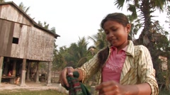 Cambodia: Girl Hangs Clothes Stock Footage