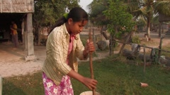 Cambodia: Girl Gets Water from Well Stock Footage