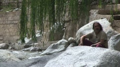 Man at Ourika river Stock Footage