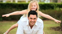 Multi-Ethnic Father & Daughter Outdoor Fun Stock Footage