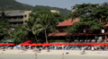 Red Umbrella on the beach, People Tanning, Kata Beach in Phuket Island Footage