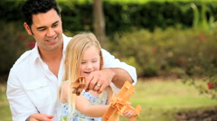 Father & Daughter Playing with Toy Airplanes - stock footage