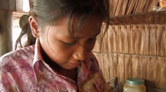 Cambodia: Girl Cuts Fish Stock Footage