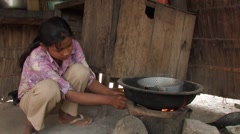 Cambodia: Girl Cooks over Fire Stock Footage