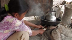 Cambodia: Girl Boils Water Stock Footage