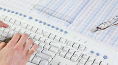 Business woman typing on a computer keyboard - stock footage