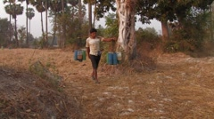 Cambodia: Bringing Home the Juice! Stock Footage