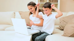Children Playing Games on Laptop Stock Footage