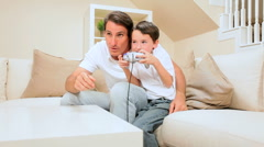 Father & Son Playing Electronic Games - stock footage