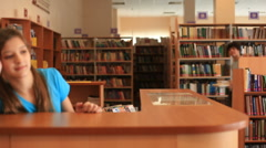Teens in library Stock Footage