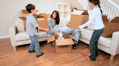 Family with Cartons to be Unpacked Stock Footage