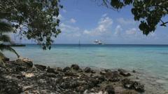 Distant cruise ship  in a Rangiroa lagoon Stock Footage