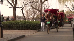 Chinese rickshaws nearby the touristic Houhai lake in Beijing Stock Footage