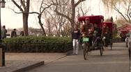 Chinese rickshaws nearby the touristic Houhai lake in Beijing Stock Footage