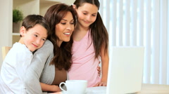 Family Looking at Laptop at Home - stock footage