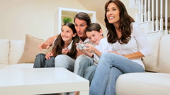 Family Encouraging Son on Games Console - stock footage
