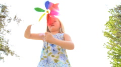 Little Blonde Girl with Pin Wheel Stock Footage