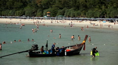 People walking, swimming, snorkeling, Kata Beach in Phuket Island, Thailand Stock Footage