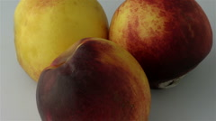 Three peaches decaying - 20 seconds Stock Footage