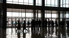 Silhouette people in enter hall Stock Footage
