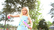 Stock Video Footage of Little Girl Playing with Bubble Wand