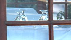 RESTAURANT TABLE VIEW FROM OUTSIDE Stock Footage
