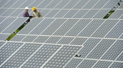 Contractors/Electricians inspecting solar panels Stock Footage