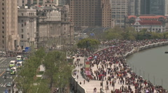 Shanghai Bund from above crowd abd trafic old buildings Stock Footage