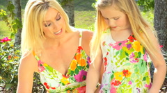 Mom & Daughter Gardening in Close-up Stock Footage