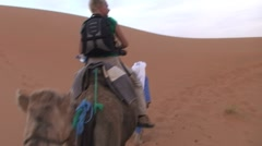 Camel ride in Sahara, Morocco Stock Footage