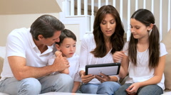 Stock Video Footage of Caucasian Family Using Wireless Tablet