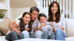 Family Enjoying Games Console - stock footage