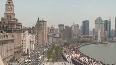 Shanghai Bund crowded with old buildings and trafic Stock Footage
