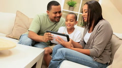 African-American Parents Watching Son with Wireless Tablet Stock Footage