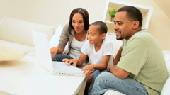 African American Family Sharing a Laptop - stock footage